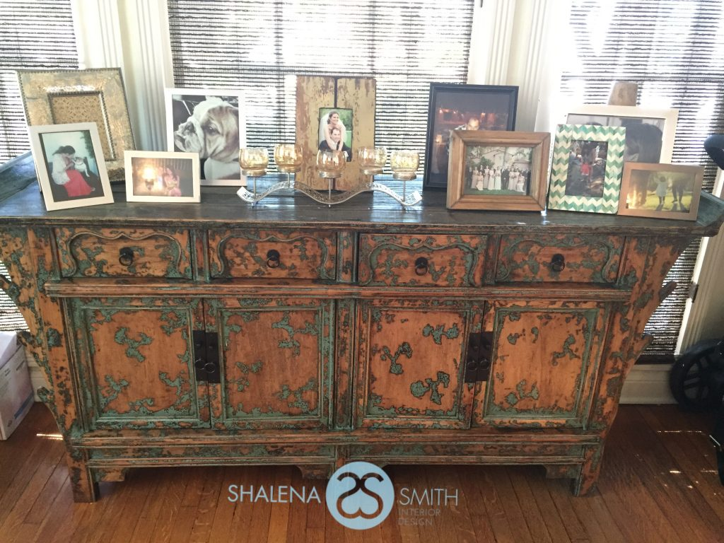 Organize and declutter giving the space a fresh new look. Plus add a few new frames and photos to update the space.